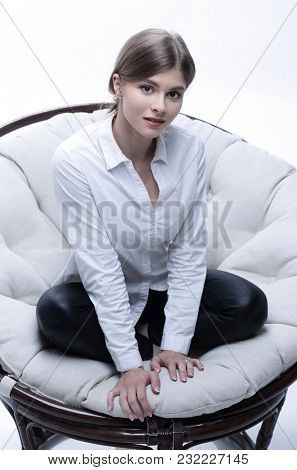 young business woman resting in a big soft chair