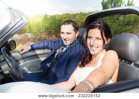 Couple Of Lovers Driving On Convertible Car Newlywed Man Woman On Romantic Date