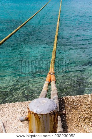 Yellow Ropes Across Aqua Water