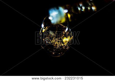 Pouring Single Malt Whisky Into A Glass, Golden Color Whisky