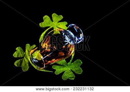 Single Malt Whisky In A Glass Of Tasting With Decoration For St. Patrick's Day, Green Clover Symbol