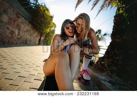 Cheerful Female Friends Having Fun Outdoors