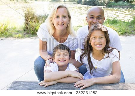 Happy Mixed Race Parents With Their Children In The Countryside Ftrom Mexican South American And Blo
