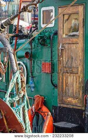 Leba, Poland - August 16, 2005: Details Of Old Fishing Boat In Port Of Leba Town Over Baltic Sea Coa