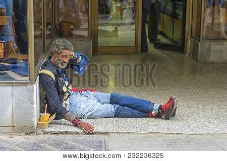 Havana, Cuba - January 04, 2018: Black Beggar Begging At The Entrance To The Store In Havana, Cuba
