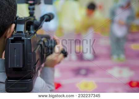 Professional Video Camera Operator Working With His Equipment, Blurred Background . Video Camera Ope