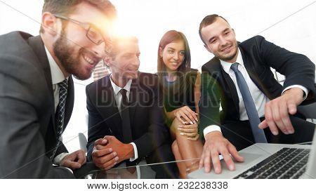 closeup.business team working on laptop.