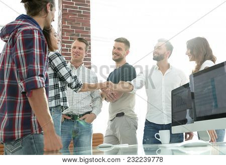business handshake in a creative office.