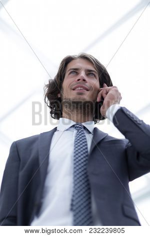 businessman talking on mobile .isolated on white.