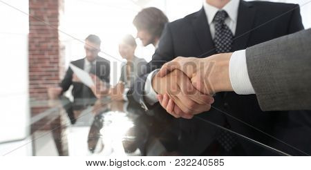 handshake of business partners in conference room