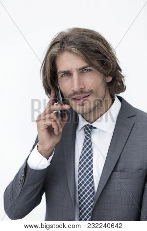 young man listening on a phone on a white background