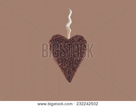 A Huge Cookie From Ground Coffee In The Form Of A Heart With Stream Of Milk On Colorful Background