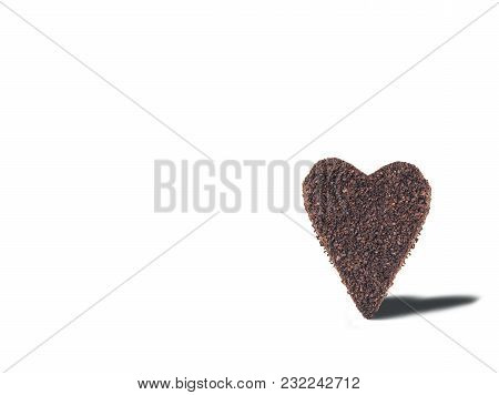 A Huge Cookie From Ground Coffee In The Form Of A Heart On A Colorful Background