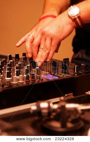 DJ paying music in the club