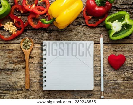 Flat Lay Of Blank Recipe Cooking Book And Utensils With Herbs And Colorful Bell Pepper Over Wooden B