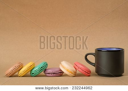 Macaroons Row And Coffee Cup On Craft With Copy Space