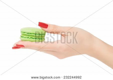 Hand Holding Green Macaroon Isolated With Clipping Path