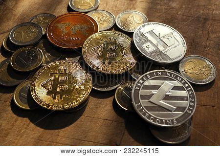 Crypto Coins With Euro Coins (fiat) On Daylight On  Dark Wooden (table) Background.  Coins Of Crypto