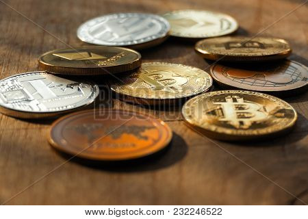 A Lot Of  Shining Crypto Coins On Dark Background. Cryptocurrency - Photo In Sunset. Beautiful Close