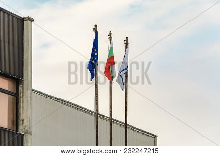 The Bulgaria Flag , Varna Flag And European Flag In Front Of The Varna Town Hall