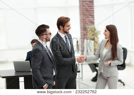 Businesswoman introduce businessman for working at office
