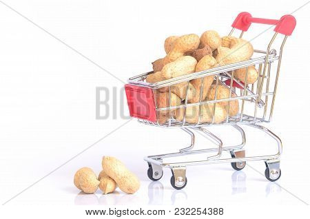 Shopping Cart With Dried Peanuts Isolated On White Background