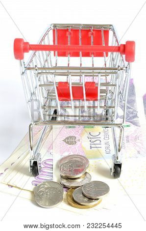 Shopping Cart And Czech Currency Money Banknotes And Coins Isolated On White Background, Rear View,