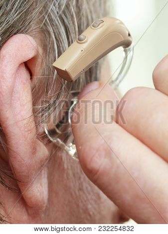 Closeup Senior Woman With Hearing Aid In Her Ear. Health Care, Hear Amplify, Device For The Deaf.