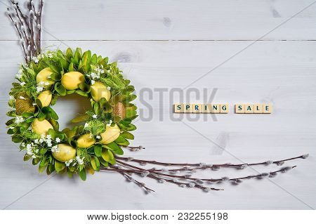 Easter Background With Eggs, Catkins And The Text Spring Sale On A White Wooden Table