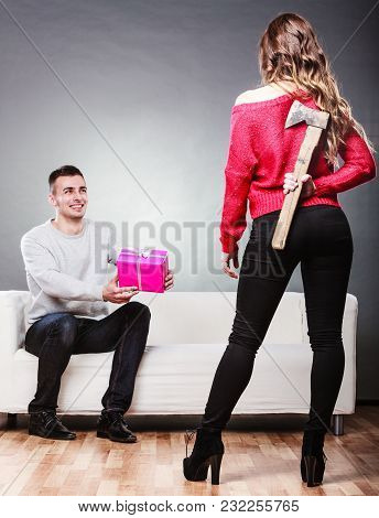 False Feelings, Relations Problem. Trusting Guy Giving Present Pink Box To Misleading Girl. Insincer