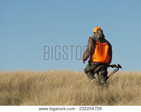 A Young Pheasant Hunter On The Prairie In South Dakota