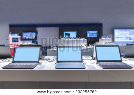 Blurred Abstract Photo Of Laptops And Electronics Store