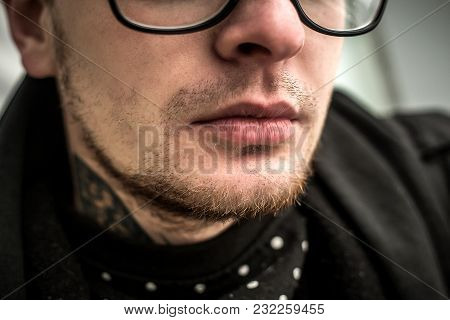 Part Of Face Of The Young Man In Glasses With Focus On Lips