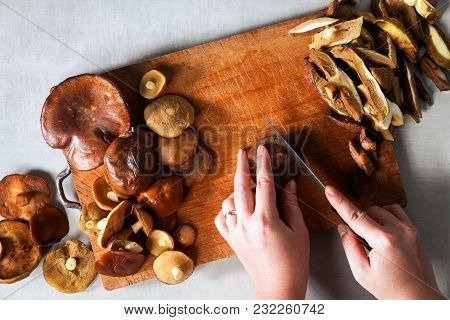 Whole And Cut Mushrooms On A Cutting Board. Process Of Cutting And Cooking On A Gray Stone Table And