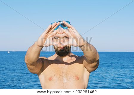 Shape Of The Heart Made By Male Hands In Snorkel Mask And Beard On Blue Sea Against Background. Happ