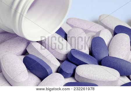 Close-up Of Drug Pills Spilled From The Tube