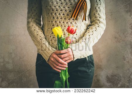 A Girl Holds A Tulips, St. George Ribbon On Clothing, Patriotic Man, May 9, Victory Day