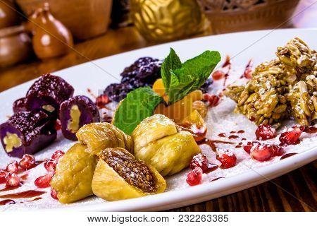 Dried Fruits, Sunflower Seed Brittle, Walnut Georgian Churchkhela On White Plate
