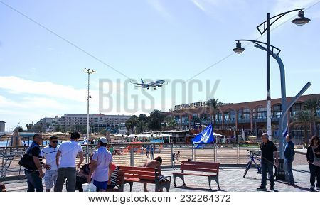 Eilat, Israel, March 13, 2015 : Tourists Are Resting On The Embankment Of The Red Sea In Eilat City