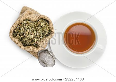 Cup Of Tea And Juta Bag With Green Tea Mixture And Infuser On White Background