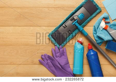 House Cleaning Products And Supplies On Wooden Background, Top View. Spring Cleaning And Household C