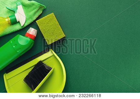 Spring Cleaning Background. Set Of Green Detergent Bottle, Sponges And Brush Isolated. Cleaning Serv