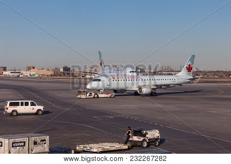Toronto, Canada - March 20, 2018: Air Canada Embraer 190 And Dreamliner On The Runway At Toronto Pea