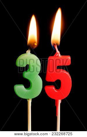 Burning Candles In The Form Of 35 Thirty Five Figures (numbers, Dates) For Cake Isolated On Black Ba