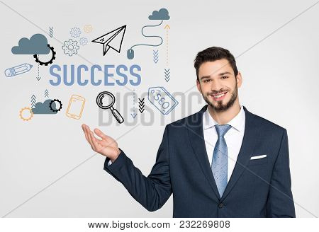Stylish Young Businessman Standing With Hand In Pocket And Talking On Smartphone While Looking Away