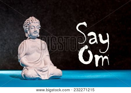 Say Om - Phrase With Little Praying Buddha. Yoga And Meditation Concept.