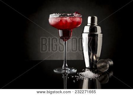 Cherry Margarita Cocktail With Tequila, Cherry Juice, Crushed Ice And Some Salt On The Rim Of A Glas