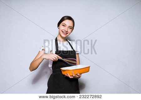 Happy Young Girl Cook In A Black Apron Preparing A Delicious Cake, Smiling