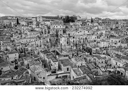 Matera The Ancient City Of Italy In Basilicata, View Of Its Old Stone Houses And Streets In Black An