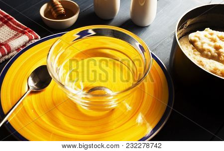 Hot Porridge Oatmeal Is About To Served Into Clear Glass Bowl